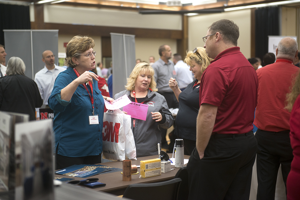 Photo of suppliers interacting with attendees at the Supplier Showcase event